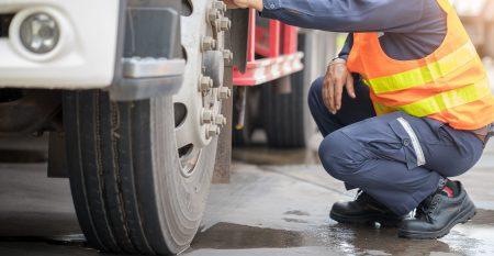 Preforming a pre-trip inspection on a truck,Concept preventive maintenance truck checklist,spot focus.